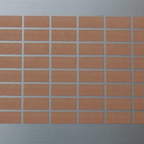 Kaltgasspritzen - lötfähige Einzelsegmente aus Kupfer auf einer Metallplatte beschichtet im Kaltgasspritzverfahren